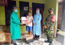 Anggota Koramil 01/Ngawi Dampingi Pembagian Paket Sembako