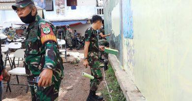 Karya Bahkti Hari Juang Kartika, TNI Polri Lakukan Pengecatan dan  Rapid Test di Petamburan II