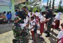 Cegah Covid-19, Satgas Yonif MR 413 Kostrad Bagikan Alkes di Sekolah Papua