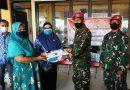 Prajurit Menkav 2 Mar Serahkan Bansos ke Warga Wonokusumo Ujung Surabaya
